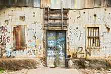 Puerto Princesa City, Palawan, Philippines: Close-up View Of The Front Of An Abandoned Ruined Building With Closed Windows And Door