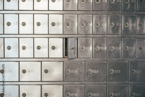 Fototapeta Private bank deposit box - close up of opened mailbox with a small key - post office box or PO BOX concept obraz