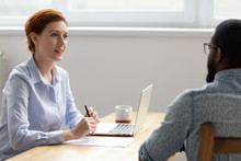 Female Businesswoman Having Good Impression From Interviewing Black Job Candidate