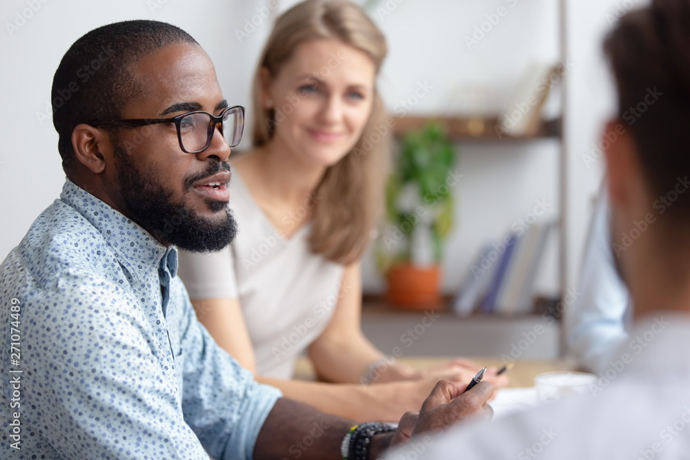 Fototapety, obrazy: Male african-american talking to coworkers timeout in office