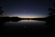The Moon And Venus Over An Exc...