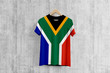 canvas print picture - South Africa flag T-shirt on hanger, African team uniform design idea for garment production. National wear.