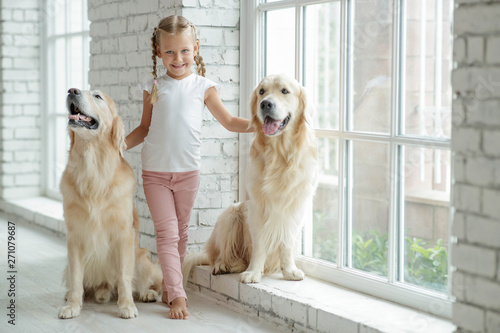 A child with a dog at home. Canvas Print