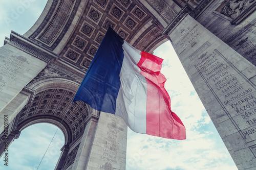 Valokuvatapetti french flag at arc de triomphe during bastille day