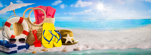 Summer holiday banner concept, beach accessories on white sand