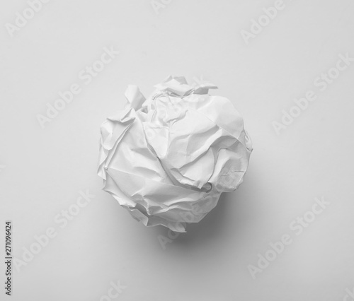 Vászonkép  Crumpled sheet of paper on white background, top view