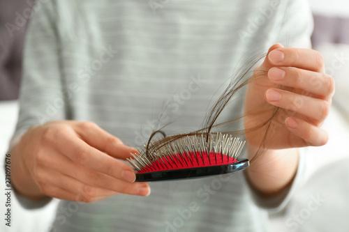 Woman holding brush with fallen long hair, closeup Canvas Print