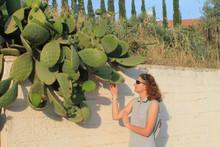 Girl Touching Opuntia Cactus