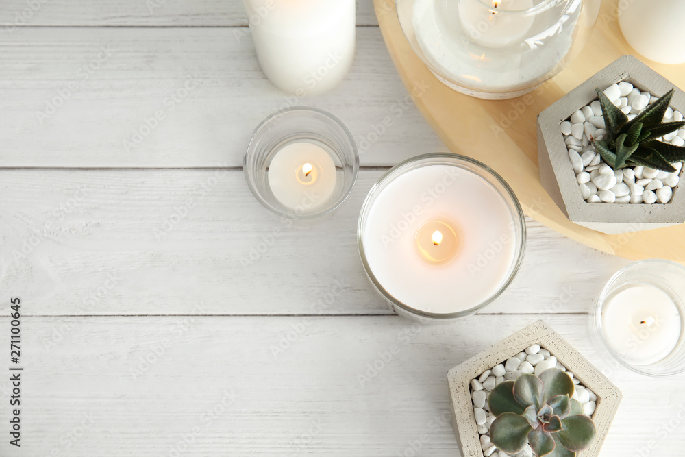 Fototapety, obrazy: Flat lay composition with burning aromatic candles and plants on wooden table. Space for text