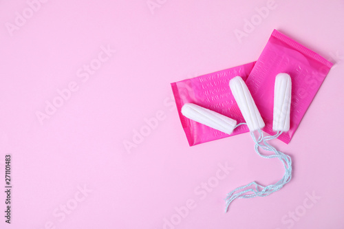 Fotografie, Obraz  Different feminine hygiene products on color background, flat lay with space for text