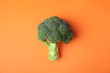 Leinwandbild Motiv Fresh green broccoli on color background, top view. Organic food