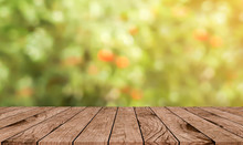 Abstract Blurred Apple Farm Garden With Brown Wood Perspective For Show,promote,ads,banner Display Concept