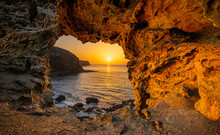 View From A Natural Rock Cave For A Beautiful Sunrise Over The Ocean.Lanzarote, Spain