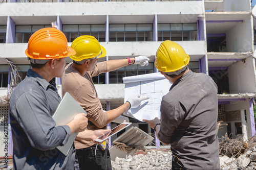 Canvas Prints Textures Engineer team and worker checking blueprint for emolition construction plan and inspect at the site.