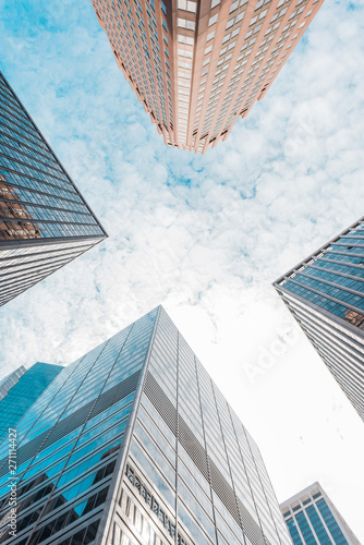 Skyscrapers in a finance district at Manhattan. New York, USA. Perspective view of modern skyscrapers glass wall. .