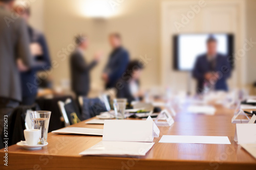Obraz businesspeople around the table in conference room - fototapety do salonu