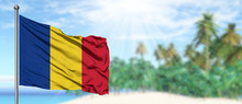 Waving Romania Flag In The Sunny Blue Sky With Summer Beach Background. Vacation Theme, Holiday Concept.