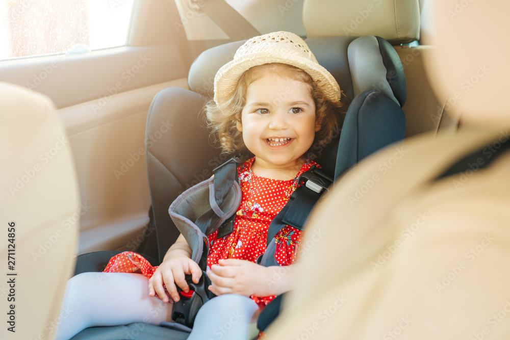 Fototapety, obrazy: Cute little baby child sitting in car seat. Portrait of cute little baby child sitting in car seat.Safety concept.