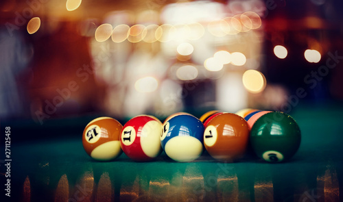 Photo Colorful billiard balls on a billiard table.