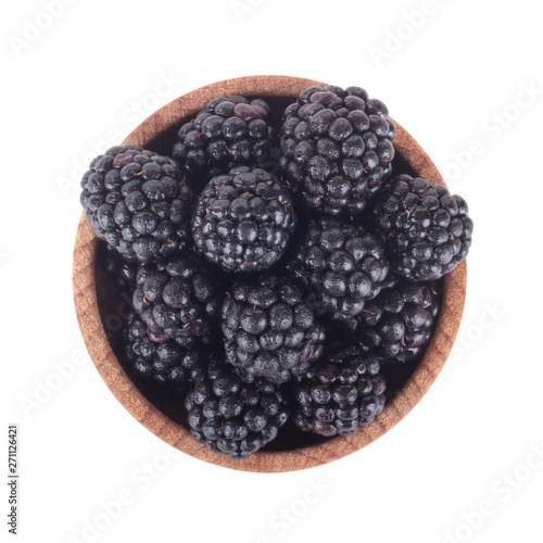 heap of blackberry in wooden cup isolated on white background Fototapeta