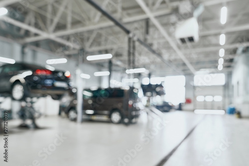 Repair service station with lifted modern cars Fototapet