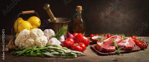 resh meat with rosemary and ingredients for cooking