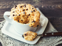 Cake In Mug With Peanut Butter And Chocolate Chips