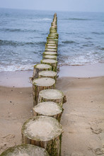 Raw Of Wooden Breakwaters At A...