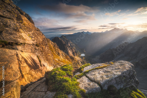 Wall Murals Pale violet Mountains Landscape with Rock and Grass in Foreground at Sunrise. Bielovodska Valley as seen from Sedlo Vaha in High Tatras, Slovakia