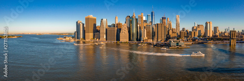 Photo sur Toile New York New York, New York, USA skyline with Brooklyn and Washington bridges near the Manhattan island.