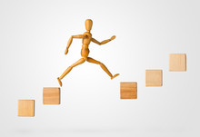 Wooden Stick Figure Jumping From One Wooden Block On Rising Steps To The Next - Achievement, Career Or Objective Concept On White