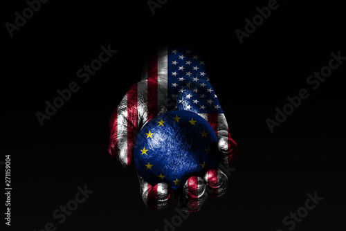 A hand with a drawn USA flag holds a ball with a drawn EU flag, a sign of influence, pressure or conservation and protection Canvas Print