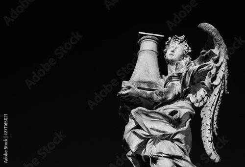 Fotografie, Obraz  Angel statue holding the Column of Jesus Passion looks at the Heaven A 17th cent