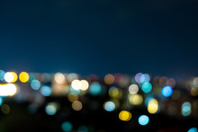 Light Bokeh City Landscape At Night Sky With Many Stars, Blurred Background Concept.