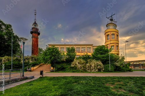 Lighthouse - a historic lighthouse on the Polish coast of the Baltic Sea, located in the Nowy Port district of the city of Gdańsk, Poland.  - fototapety na wymiar