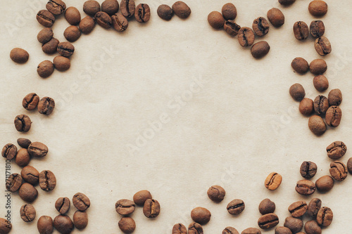 Photo sur Aluminium Café en grains Fried coffee beans on paper background. Top view with copy space.