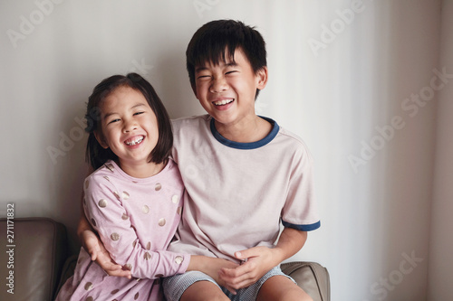 Fototapeta Laughing Asian little brother and sister at home , Happy children portrait