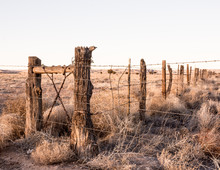 Wooden Fence With Barbed Wire ...
