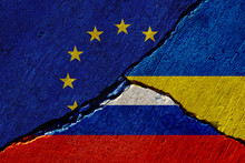 Cracked Concrete Wall With Painted Eu, Russia And Ukraine Flags