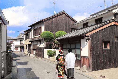 Man and woman in traditional Japanese clothes, Bikan district, Kurashiki, Japan