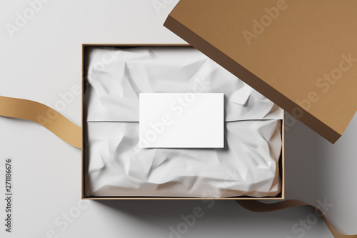 Foto Open realistic cardboard box with white packaging card and fabric tape