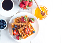 Fresh Homemade Food Of Berry Belgian Waffles With Honey, Chocolate, Strawberry, Blueberry, Maple Syrup And Cream. Healthy Dessert Breakfast Concept With Juice