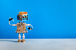 canvas print picture - Mechanical robot cheerful face, cogs wheels machine parts body. Creative design robotic toy on blue gray background. copy space