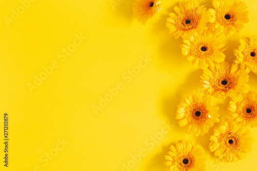 Door stickers Gerbera Flowers composition. Yellow gerbera flowers on yellow background. Summer concept. Flat lay, top view, copy space