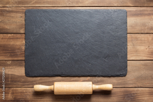 Fotografie, Obraz  slate stone at rustic wooden plank board table