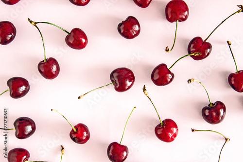 Obraz na plátně  Cherry berries on a pink background top view