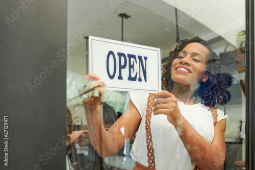 Valokuva Pretty young Black woman opening her store in the morning