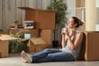 Leinwanddruck Bild - Happy tenant moving home resting breathing fresh air
