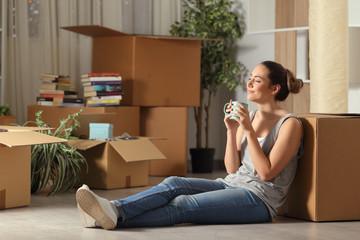 Happy tenant moving home resting breathing fresh air