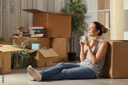 Fototapeta Happy tenant moving home resting breathing fresh air obraz